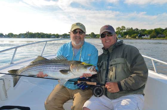 Captain Peter Whelan with RJ Mere targeting striper on the